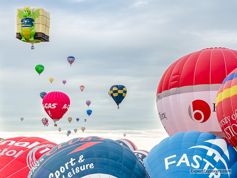 Many colorful balloons take off from the Bristol International Balloon Fiesta