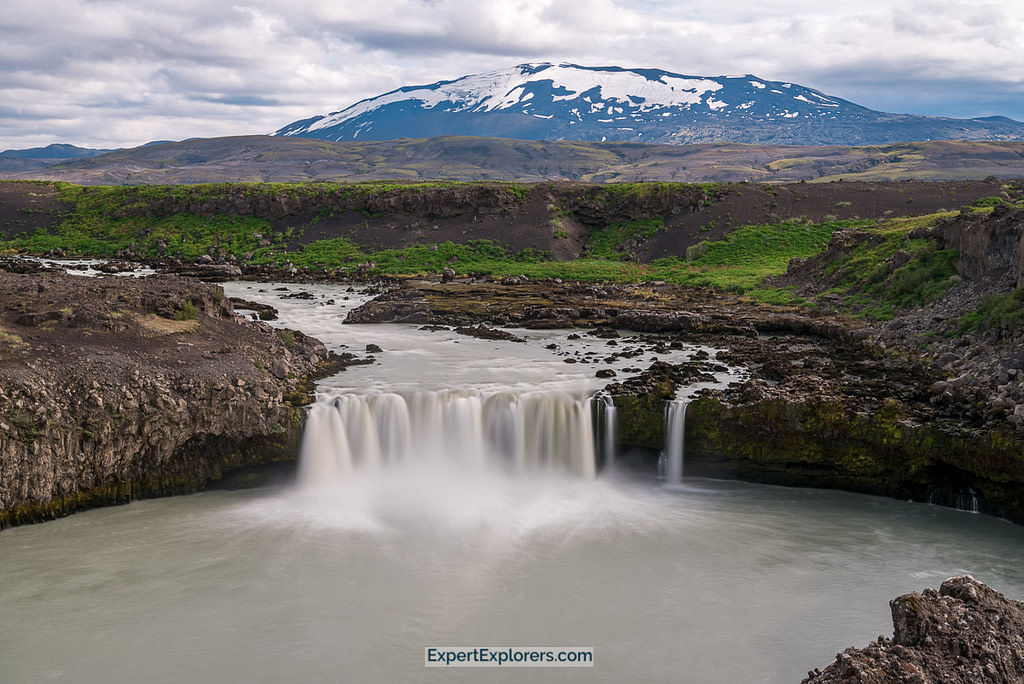 View of Þjófafoss Waterfall with the Volcano Hekla in the background, Iceland.