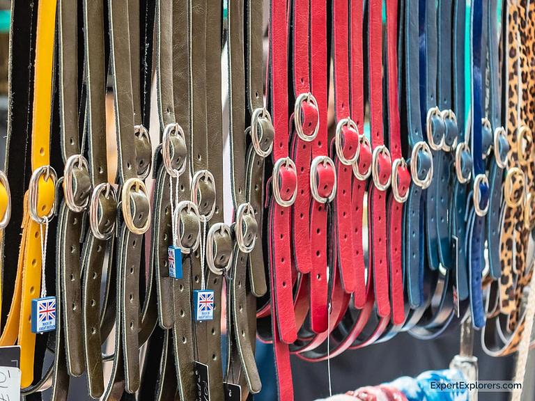Multi-colored belts hang at Spitalfields Market London