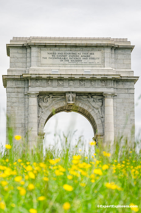 National Memorial Arch with yellow flowers in foreground at Valley Forge National Park, Pennsylvania