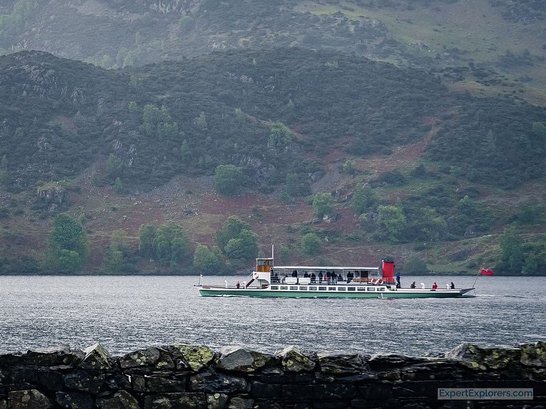 Steamer making its way across the Ullswater in the Lake District England