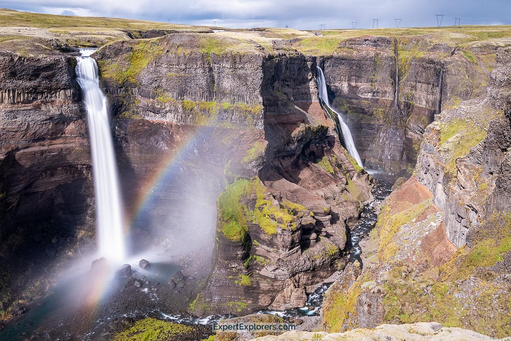 Haifoss waterfall creates its own rainbow as the water crashes down on the rocks below. Granni waterfall in the background.