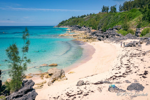 Couple snorkeling in the crystal clear blue waters of Church Bay, One of Bermuda's Best Beaches