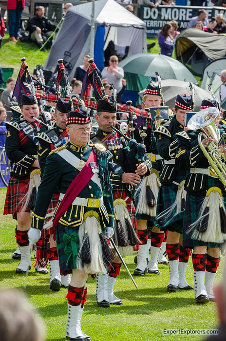 Band marching and playing bag pipes at Crieff Highland Gathering