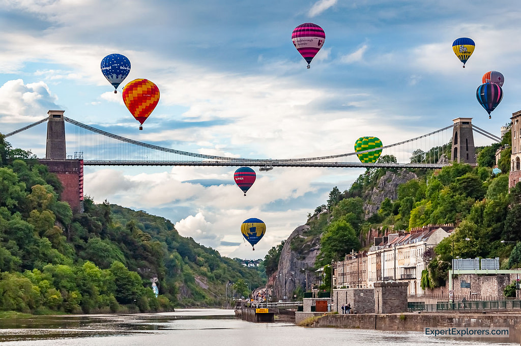 Hot air balloons from the Bristol International Balloon Fiesta fly over the Clifton Suspension Bridge and the Avon Gorge.