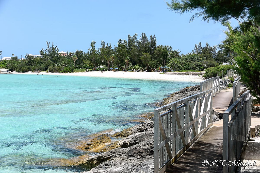 Bridges of the Rail Road Trail in front of crystal clear blue waters of Shelly Bay one of Bermuda's Best Beaches