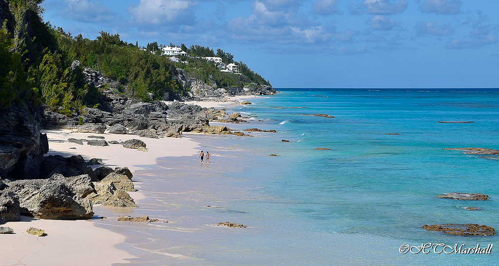 Couple walking the pink sand shore of Southlands beach in Bermuda