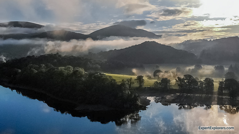 Derwentwater at sunrise elevated view taken with drone in the Lake District England
