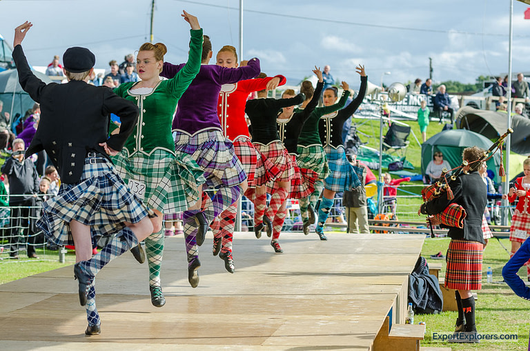 Dancers wearing traditional attire perform highland dancing
