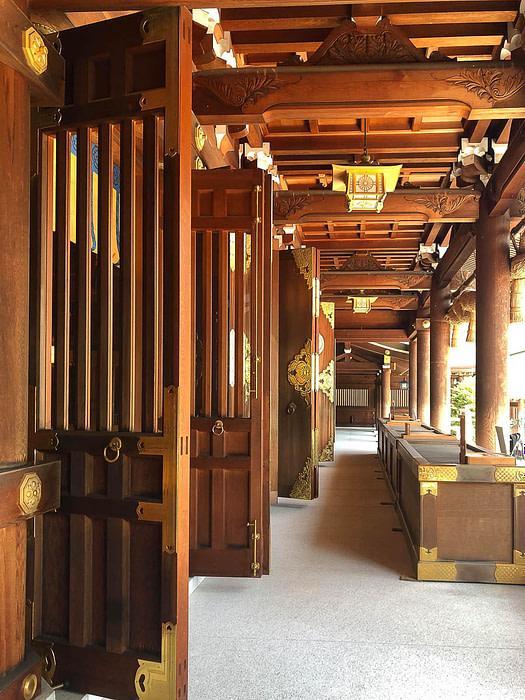 Large open wooden doors at Samukawa Shrine in Chigasaki, Japan