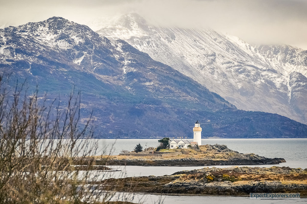 View over Isle Ornsay Lighthouse with mountains in the background, Isle of Skye, Scotland