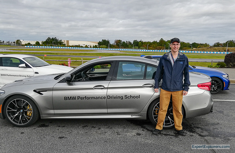 Jeremy standing in front of the M5 at the BMW Performance Center