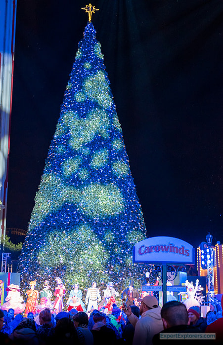 The parade finale and dance party with the cast at the giant Christmas Tree in Celebration Plaza
