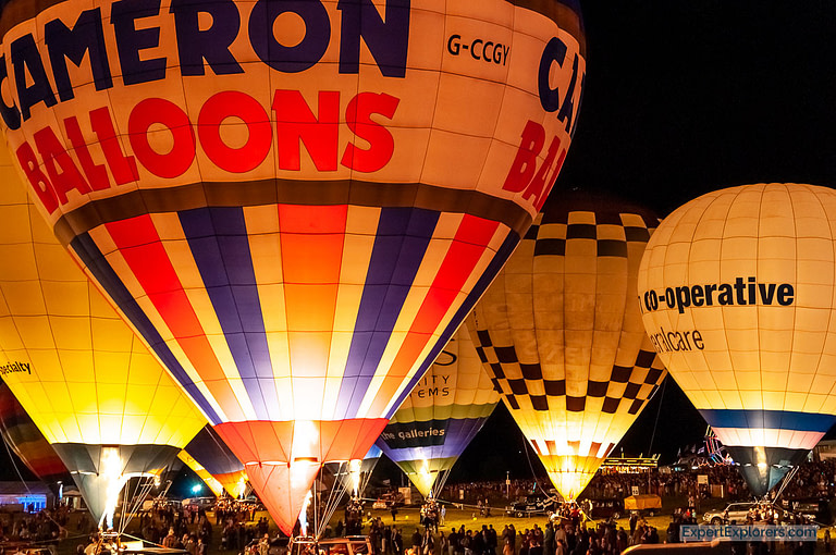 Close up of hot air balloons lit for the Nightglow event during the Bristol International Balloon Fiesta