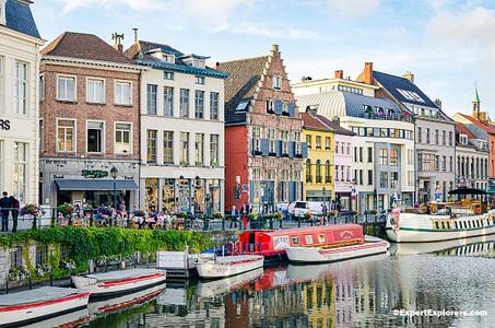 Buildings and boats lines Kraanlei quay in Ghent