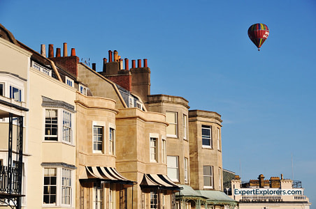 Hot air balloon flying over Clifton homes
