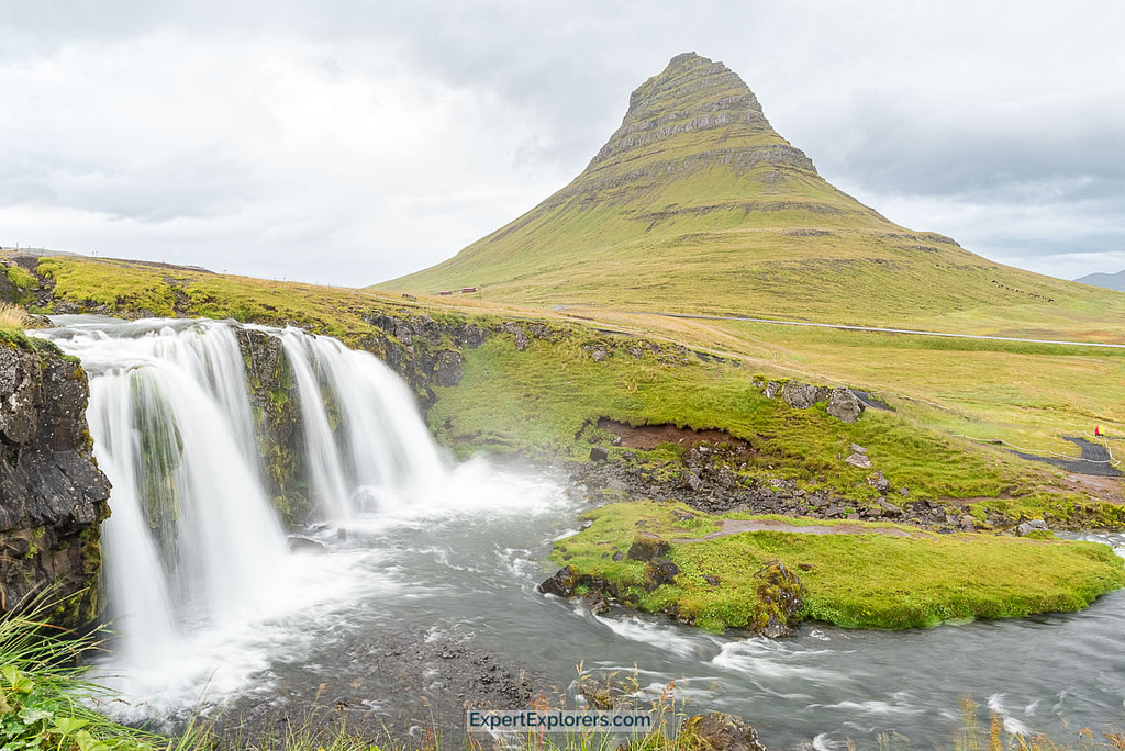 The iconic Kirkjufellsfoss with the witch hat shaped Kirkjufell mountain in the background, Iceland.