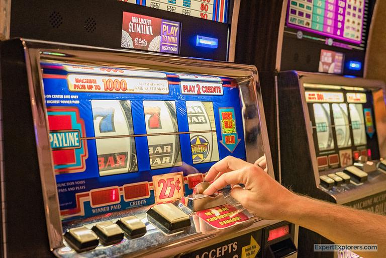 Playing the quarter slots in El Cortez, Fremont Street, Downtown Las Vegas