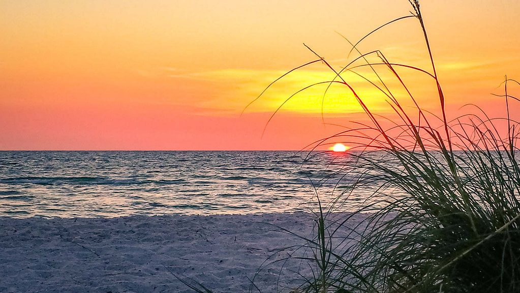 Bright red, orange and yellow sunset at Redington Shores Beach in Florida