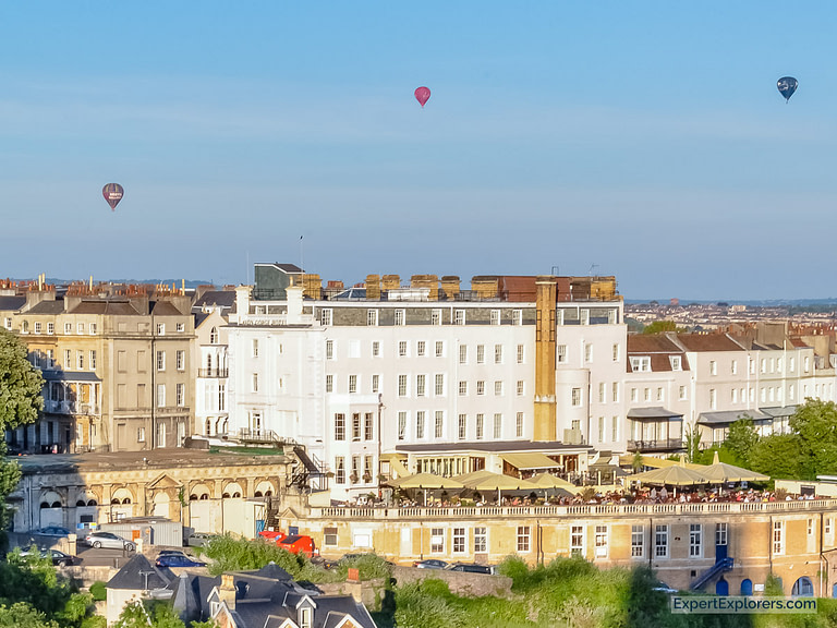 Balcony of Avon Gorge Hotel as hot air balloons float overhead