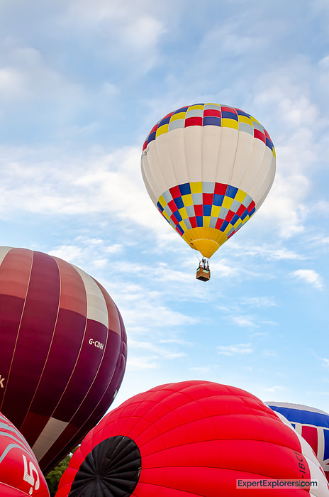 Balloon takes off out of the crowd at the Bristol International Balloon Fiesta