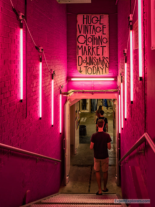 Vintage Market Stairs with Pink Lighting