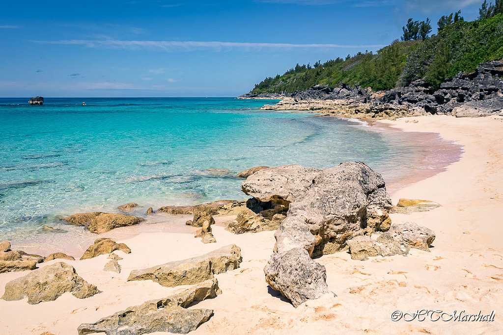Crystal clear blue waters and pink sand of Church Bay, One of Bermuda's Best Beaches