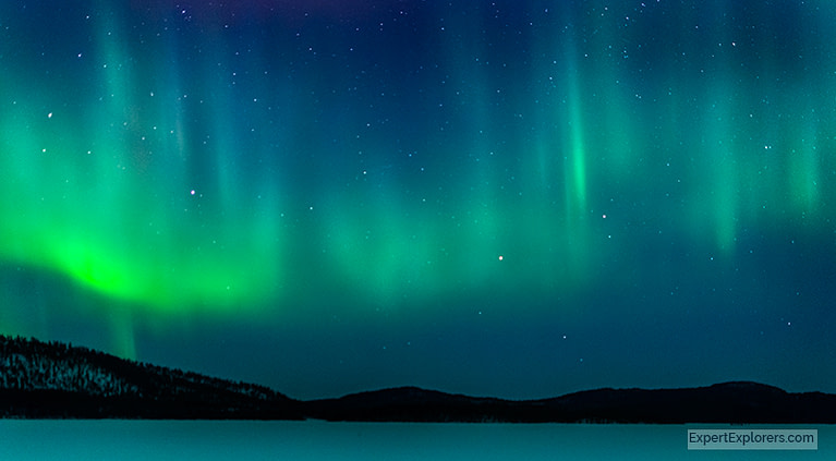 View of the Northern Lights from Ukonjarven Holiday Village in Ivalo, Finland