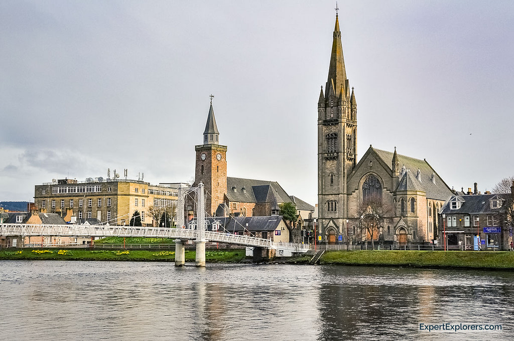View of the bridge over the river Ness, churches and city of Inverness, Scotland